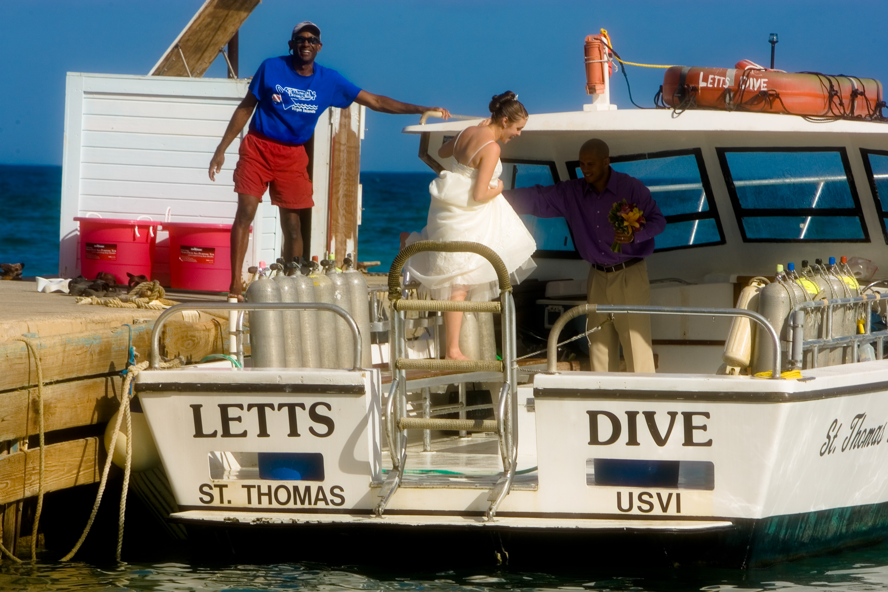 Lara and her new husband on the dive boat with the owner of the STDC Andre Webber.